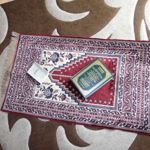 The prayer mat and Quran is my path to life. If I'm ever pulled to a wrong destination, I know where to jump on board to be on the right track. My religion, Islam, gives me peace, clarity and a sense of purpose.