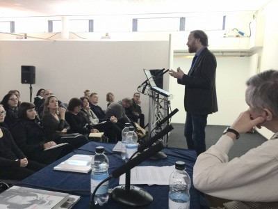 Simon Baker during the PhotoVoice panel discussion at the London Art Fair