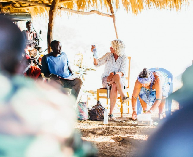 Melinda Watson discussing with local scouts, Milgis Trust, Kenya. 2015.