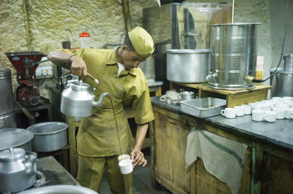 """A cook pours coffee in the kitchens of the Indian Coffee House, Shimla, India. From the book, The Palaces of Memory - Tales from the Indian Coffee House (pub. Dewi Lewis 2015)"" ©Stuart Freedman"