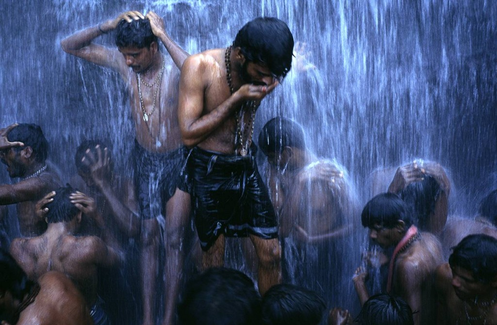 """""""Followers of the Shiva sect of Hinduism ritually bathe at a waterfall in Courtalam, Tamil Nadu, India."""" ©Stuart Freedman"""