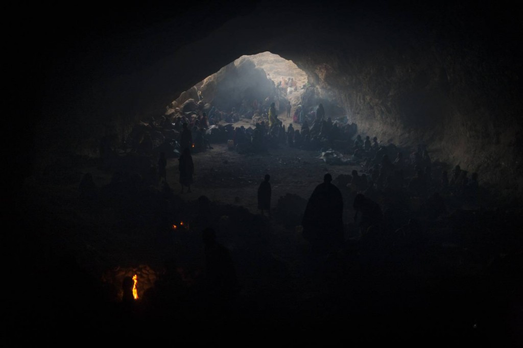 """© Adriane Ohanesian """"Hundreds of women and children who have fled the fighting or are seeking shelter from the continued bombing by the Sudanese government's forces, live in a cave in Central Darfur, Sudan, March 2, 2015."""""""