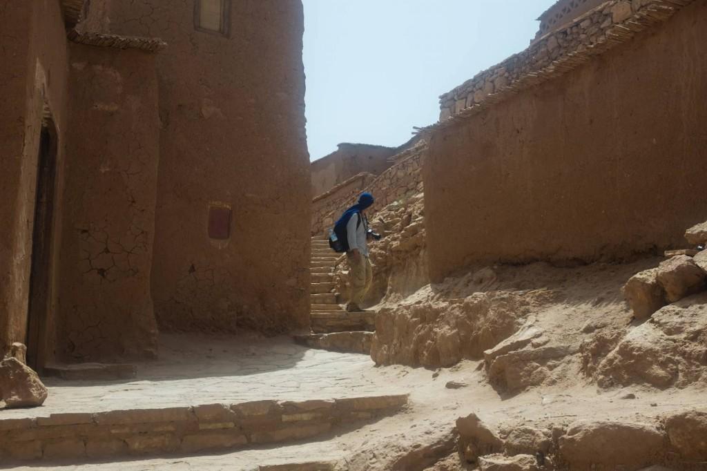 American tourist walking through Moroccan desert village Aït Benhaddou. June 2017